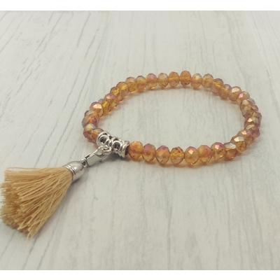 Bracelet ambre en perles de verre et pompon