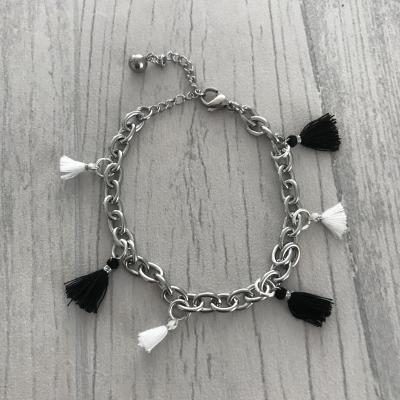 Bracelet pompons noirs et blancs