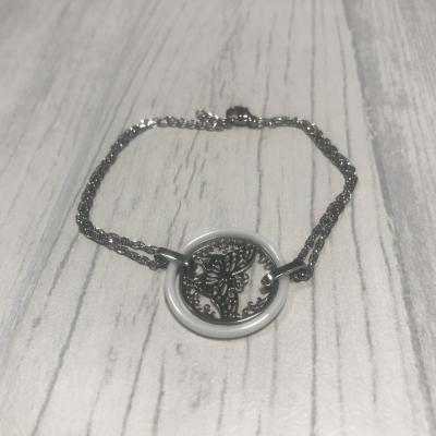 Bracelet en acier et papillon céramique blanc